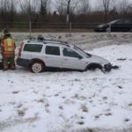 The car being pulled out of the median by a tow truck