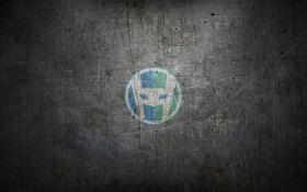 HeroPress logo on scuffed metal