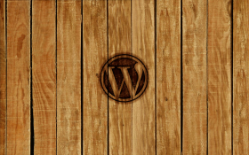 Rough hewn wood paneling, WordPress logo branded into the center