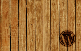 Rough hewn wood paneling, WordPress logo branded into the bottom right