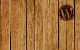 Rough hewn wood paneling, WordPress logo branded into the top right