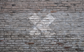 X-Team Logo in White on Grey Brick