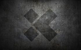 X-team Logo on Scuffed Metal