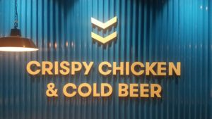 The sign says Crispy Chicken and Cold Beer
