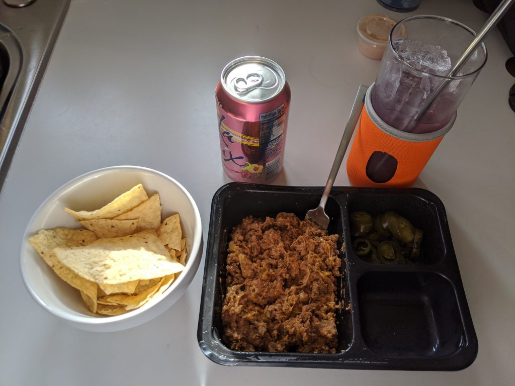 La Croix mixed with lemonade, chips, and taco meat in a bowl